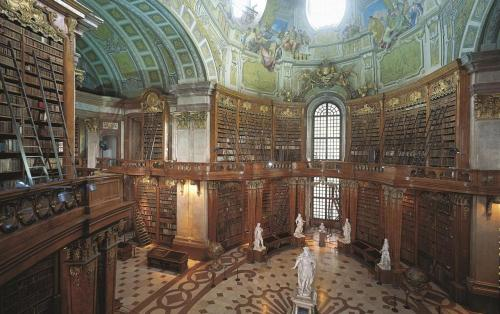 The Austrian National Library (German: Österreichische Nationalbibliothek) is, with 7.4 million items in its collections, the largest library in Austria. It is located in the Hofburg Palace in Vienna; since 2005 some of the collections find themselves in the baroque Palais Mollard-Clary. Founded by the Habsburgs, the library was originally located in the current Prunksaal building and called the Hofbibliothek, changing to its current name after 1920[1] The collections consist of: papyri, manuscripts, ancient and rare books, maps, globes, music, portraits, graphics, photographs, autographs and posters as well as works in and on Esperanto and other artificial languages are stored in the various collections and are available for scientific research.