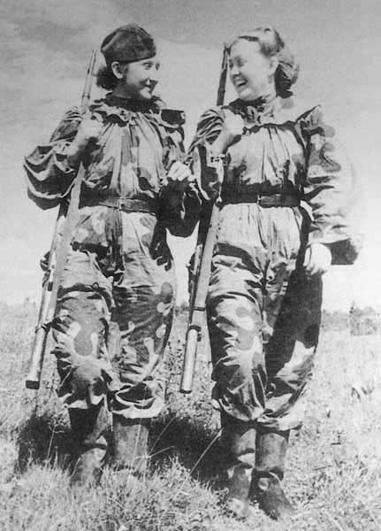 "talesofwar:  Two Russian female snipers having a laugh. They're wearing the Soviet camo Amoeba suit.  ""so i shot a wehrmacht soldier in the eye and guess what?afterwards he could NA-ZI!! har har har"""