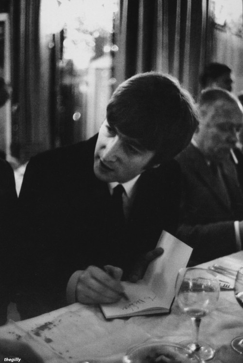 John signing autographs (to someone called Nicholas) at Foyle's Literary Luncheon, 23 April 1964. Photo by Terence Spencer.