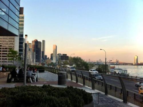 16 April 2012. Dinner at Riverpark. East River vista and grilled calamari salad (fave)… yum!  Why not. ~ MLH