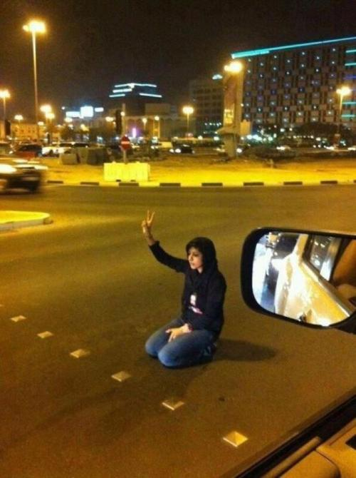frommadon:  Zainab al-Khawaja protesting alone in the streets of Bahrain against the arrest and detention of her father, Abdulhadi al-Khawaja—a revered human rights defender—who entered the seventieth-day of his hunger strike. She was arrested by Bahraini security forces shortly after this photo was taken.  More on Abdulhadi al-Khawaja