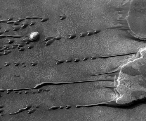 (via Astronomy Picture of the Day) Flowing Barchan Sand Dunes on Mars Image Credit: HiRISE, MRO, LPL (U. Arizona), NASA