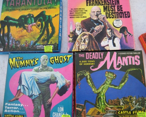 From this morning's trip to the flea market: old 8mm horror films that were extremely tempting to buy if only for the stunning design, and packaging that looked like it hadn't been exposed to light since the day these were produced.