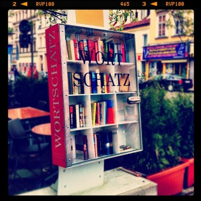 eluminx:  Free public book library 👍 Open 24/7 #books #library #shelf #bookstore #free #public #vienna #wien #iphone4 #iphoneonly (Taken with Instagram at 5er Bräu)  Ok seriously Vienna is the raddest place in the world. I miss it, and all of the friends I have made there, more then words can explain. Also, an aside, this is one of the most beautiful uses of the German language I have ever seen. Wortschatz = Vocabulary   Wort Schatz = Word Treasure.