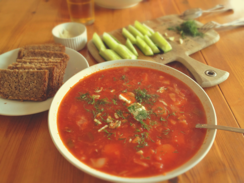 Russian Borscht soup recipe:  Boil potatoes and cabbage in stock. Fry up grated carrot, onion, and beetroot. Add can of chopped tomatoes. Combine and simmer until delicious. Serve with fresh dill, garlic, cucumber and rye bread.