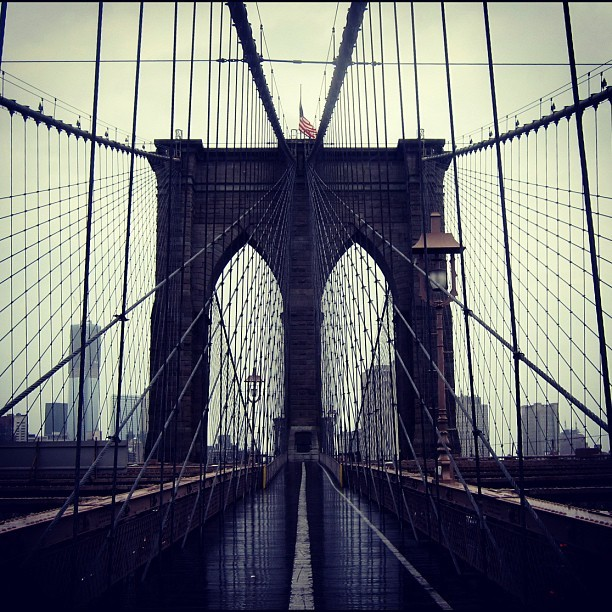 brooklyn bridge, eerily devoid of human presence on a rainy sunday morning. i imagined a horde of zombies waiting for me on the other side. thus, it was actually kind of intriguing, the thought of being ripped apart by the psychotic masses. (Taken with Instagram at Brooklyn Bridge)