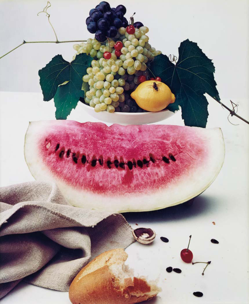 "Irving Penn, ""Still Life with Watermelon, New York"" (1947) Dye transfer print mounted, 24 x 19 7/8 inches (610 x 505 mm), signed, annotated in ink and Penn/Conde Nast copyright credit reproduction limitation stamps (on the reverse of the mount). Emulson surface with craquelure, but overall an extraordinarily attractive image, probably printed 1960s or 1970s. Penn Moments Preserved p. 117; Szarkowski Irving Penn 1984, plate 63; Penn Passage: A Work Record p. 41."
