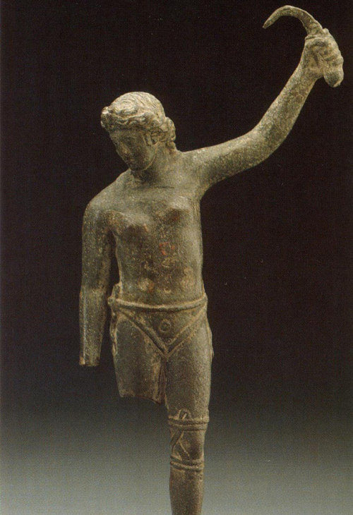 "brain-food:  The Gladiatrix: 2,000-year-old statue shows topless female gladiator standing triumphant over defeated foe.The statue is only the second known depiction of a woman gladiator, study says. It was previously considered a cleaning tool, the statue's blade may be a weapon.  Female-gladiator fights appear to have been rare spectacles in the Roman Empire. But new analysis of a statue in a German museum adds to the evidence that trained women did fight to the death in ancient amphitheaters, a new study says. The bronze statuette is only the second known representation of a female gladiator, according to study author Alfonso Manas, of Spain's University of Granada. (Related: ""Huge Gladiator School Found Buried in Austria."") The roughly 2,000-year-old artwork, which resides at the Museum für Kunst und Gewerbein in Hamburg, shows a bare-chested woman in a loincloth brandishing a scythe-like object in her left hand. Manas believes the woman is holding a sica, a short, curved sword associated with a type of gladiator known as a thraex, or Thracian. Thraexes typically fought in plumed helmets, with small shields and metal leg guards called greaves. Their unarmored backs were particularly vulnerable—and were likely ripe targets forsica. Experts had previously interpreted the curved implement as a strigil, which Romans used for scraping the body clean. The woman's pose, though, doesn't support that explanation, Manas said. Victory Pose? If she were washing herself, ""raising the cleaning tool in her hand while she's looking at the ground doesn't make sense,"" Manas said. Furthermore, ""she is wearing a cloth around her genital area,"" he added. ""If she is cleaning herself, she would be completely naked."" The figure's lowered head and raised arm—""a typical victory gesture of gladiators"" in Roman art—instead suggest a gladiator standing over her defeated rival, according to Manas. This gesture may also account for the figure's lack of a helmet or shield. At the ends of contests, ""they put down their helmet so that all the spectators could see the face of the winning gladiator,"" Manas said. ""They also threw their shield to the ground."" (See ""Gladiators Played by the Rules, Skulls Suggest."") ""An Erotic Impact"" As for being topless, that was also the gladiatorial norm. ""One of the rules of a gladiatorial fight was that women or men fought with bare chests,"" Manas explained. Given the largely male audience for the competitions, however, perhaps there's another reason why lady gladiators fought bare-chested. Reporting his findings in a recent issue of the International Journal of the History of Sport, Manas wrote: ""No doubt the particular appearance of female gladiators would also cause an erotic impact on viewers."" The only other known visual record of female gladiators is a first- or second-century A.D. relief from a Roman site in Bodrum, Turkey (now in the British Museum). The scarcity of such finds suggests that the ancient world staged relatively few all-female contests, although Roman writers do refer to them. There are eyewitness accounts of female gladiators in Rome itself, and, according to the first-century historian Suetonius, Emperor Domitian made women fight by torchlight at night. In A.D. 200 another emperor, Septimius Severus, banned female contests. Manas added that the origin of the Hamburg museum statuette isn't known, however, ""it's in the style of the Italian peninsula in the first century A.D."""