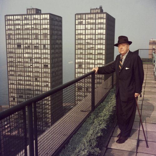 Mies van der Rohe photographed by Slim Aarons, 1960, Chicago. He's standing before his two landmark buildings, 860-880 Lake Shore Drive.