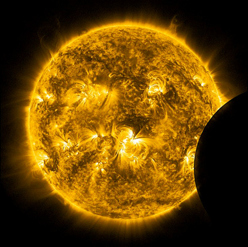 ikenbot:  Partial Solar Eclipse Credit & Copyright: NASA/Solar Dynamics Observatory