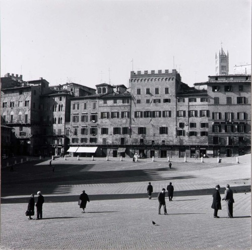 cahieramericain:  Harry CallahanSiena, Italy 1968 The Piazza del Campo in Siena is anything but congruous. It's disparity is what makes it so jarring; one is constantly forced to reframe their perspective. Callahan's print of the almost barren but never lifeless Piazza pays respect to this unique built environment and to the fascinating people that populate it. Though not my favorite Harry Callahan work, I deeply enjoy photographs that convey authenticity in iconic and photogenic locales which have been serialized through day tripper's snapshots and mass produced postcards.
