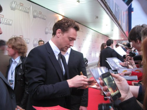 Hey, look! Now I can tell everyone that I've got a photo with Tom Hiddleston. Well, he signs my photo, there's my hand, so… Let it be xDD   photo by Catherine Stomahina