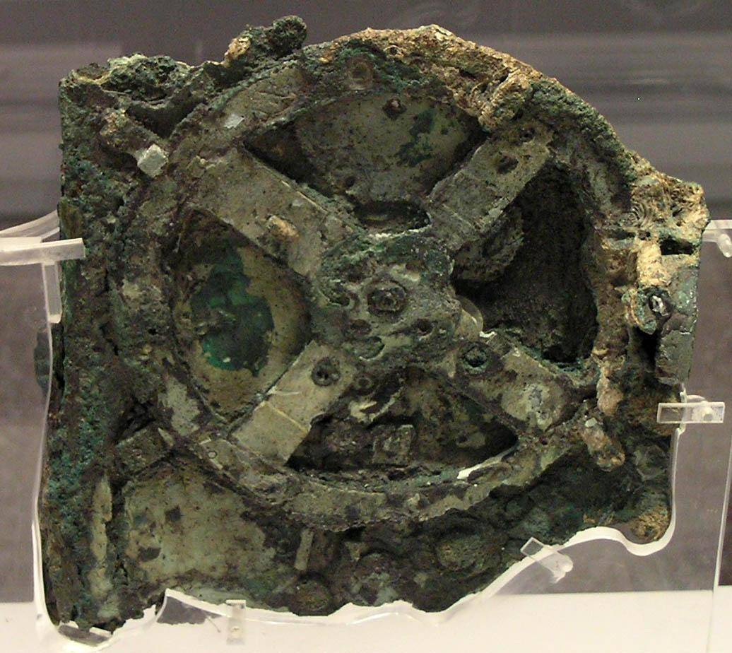 quantumaniac:  The Antikythera Mechanism. Antikythera is an insignificant small Greek island in the Aegean Sea. In 1900, sponge divers discovered a shipwreck there dating back to the 1st century BC. Aside from the artefacts you would expect to recover from a trading vessel of the period, there was also a small, enigmatic box that turned out to be an extraordinary find, inspiring one noted scholar to claim it more valuable than theMona Lisa.   Because of its fragile condition and our inability to see inside it at that time, this mechanical conundrum was put on the backburner as perhaps an anachronism that was way too complex to have been created by ancient Greeks. However, beginning in the 1950s, much investigation has gone into deciphering its secrets. In fact, the latest studies show the level of miniaturisation of intricate gears within was on a par with 19th-century clocks. It now appears this device performed many tasks. Composed of 30 gears and a number of faces and dials, it stakes a claim to being the first analog computer. Its internal construction and movements are based on astronomical and mathematical theories developed by Greek astronomers of the Hellenistic period. It's thought to be possibly connected to Archimedes and his teachings because the inscriptions of the months on its face are those used in Corinth and its colonies, where he lived, and he was known for designing innovative machines. With the use of modern, non-invasive methods to determine its interior structure, we came to understand it could predict the positions of the known planets, sun and moon, much like a modern planetarium. Furthermore, it could be used as a calendar with compensation for the extra quarter day of the solar year. As well as having a spherical model of the moon that could show its current phase, it could also forecast eclipses and simulate the anomaly in the moon's angular velocity. Brilliant - but there's more. It indicated which years were to feature the Olympic Games