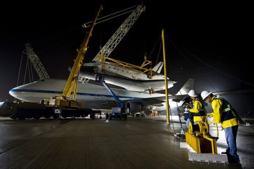 shuttleisland:  Workers monitor the lift of the space shuttle Discovery from the the NASA 747 Shuttle Carrier Aircraft (SCA) at Washington Dulles International AirportPhoto Credit: (NASA/Bill Ingalls)