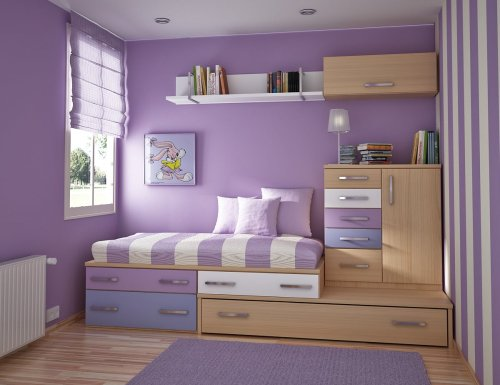 Space-saving furniture used here in a simple, but playful girls' bedroom!