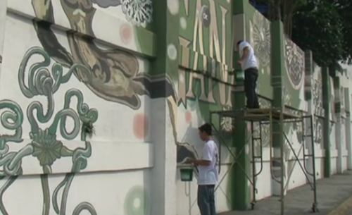 wildcat2030:  Manila is one of the world's five dirtiest cities, but graffiti? That's not a problem. It's not that people don't paint on the walls in the hyper-polluted Philippines capital, because they do. But they do it with a paint that actually eats smog out of the air. The catalytic paint, called Boysen KNOxOUT, reacts with light and water vapor to filter out nitrogen oxides. An environmental scientist interviewed in this BBC video says it can scrub out 20 percent of polluting nitrogen. Manila is deploying the paint in the form of massive murals, which are both beautiful and, because of their size, effective. Eleven square feet of paint-covered surface can absorb as much pollution as a full-grown tree, and these murals are close to 11 THOUSAND square feet. If we could get this stuff into the hands of street artists and taggers, it would be like having an army of energetic teenagers planting trees all over the city all day, every day. (via Super-polluted city tries to clean itself with smog-eating paint | Grist)  The thing that intrigues me most is the picture itself. See that curly, intestinal thing at the left bottom corner? It's a deep sea brittle star, quite probably something related to genus Asteronyx. Compare that with this:  In living specimens, the color would be brilliant red. It's very unusual to see obscure deep sea species suddenly crop up in places as public as street graffiti. Yes, the news itself is incredible. I wish street artists of my city could use those paints too.