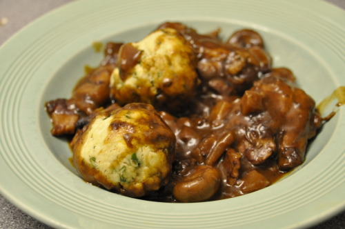 "No. 34: Coq au Vin with Herby Dumplings – 21.4.12   Oh Gizzi how I've missed you!! I'm sorry I left you for Rachel Khoo but you know I'll always love you!  My big sister bought me Gizzi Erskine's Kitchen Magic for Christmas and after already loving Gizzi through her tv shows I fell in love with it. Then watching Rachel Khoo on tv made me instantly fall in love with her, making me buy her book as soon as I could. However I've been cooking a lot of Rachel Khoo recipes recently so I'm going back to Gizzi!   And yes, I know I've already had 'Coq au Vin' this week but I don't care. I really wanted to try the traditional stew version of a Coq au Vin because I adored the flavours of the skewer version I had tried so felt I should give the traditional version a go. And yes, I know dumplings aren't traditionally French and this is stated in the recipe but they work really well with the stew and add a lovely extra dimension of texture (they're also really good at wiping up left over sauce at the end of the meal!). This recipe is from her book ""Gizzi's Kitchen Magic"".   Serves 4, preheat the oven to 180oC!   (This list is in the order you use the ingredients)    For the Stew   2 tbsp  Olive Oil8 free-range chicken thighs, boned, skinned and halved (if you're not sure about removing bones or removing the skin, just ask your butcher to do it)Pinch sea salt and ground black pepper16 button mushrooms4 rashers of smoked streaky bacon, chopped into lardons2 banana shallots, finely sliced1 large carrot, peeled and finely diced 3 cloves of garlic, peeled and chopped1 tbsp plain white flour1 tbsp tomato puree600ml red wine300ml chicken stock1 bouquet garni (This is a bundle of herbs tied together to flavour stews and soups which is removed at the end of cooking) Made of Bay leaves, fresh thyme and fresh parsley tied in a bundle.   For the Dumplings100g Self raising flour½ tsp salt1 and ½ tsp olive oila small handful of fresh parsley, chopped3 tsp snipped fresh chives60ml semi-skimmed milk    Heat1tbsp of the oil in a large heavy-based, lidded casserole dish. Season the chicken thighs with the salt and pepper and brown these in 2 batches. Cook for 4 minutes on each side and set aside. Throw in the mushrooms, cook in the oil and chicken juices for 5 minutes or until golden and set aside with the chicken. If the bottom of the pan seems dry, add a little boiling water to scrape the bottom of the pan.   Add the remaining oil to the pan and cook the bacon on a high heat for 2 minutes. Reduce the heat and add the shallots and carrot. Cover with a lid and sweat these for 10 minutes on a low heat, throwing in the garlic at the last minute. Add the plain flour and tomato purée and stir to coat all the vegetables for a minute.    Slowly pour in the wine, stirring continuously to emulsify the sauce (you'll see it thicken up as you stir). Add the chicken stock, chicken thighs, mushrooms, bouquet garni and give it a good stir! Cover, place in the oven and cook for an hour, stirring it half way through cooking.   To make the dumplings, add the the dumpling ingredients into a bowl and mix together. Then divide the mixture to make 8 small balls (these will double in size when they cook). When the stew has 20 minutes left add the dumplings and cover with the lid. Remove the lid for the last 5 minutes so they become golden brown on top.   Not tooting my own horn here, but I think this was one of the best meals I have ever made. It was absolutely amazing! The sauce was wonderfully rich from the wine and the chicken was so soft and tender from being cooked for so long. When you cut open the chicken thighs, they were a rich dark brown/red on the outside but a gorgeous white in the middle. I used Parsnip instead of carrot (due to my IBS) but my point is, is that the vegetables in the dish gave subtle little hints of flavours. There were a lot of different textures in the dish, the soft chicken, the silky sauce, the little pieces of bacon and the soft, chewy dumplings. The dumplings were a really nice addition! I'm not sure what it would usually be served with but they worked really well with the stew and soaked up some of the flavours whilst cooking. I loved this dish and it seems my boyfriend was pretty blown away by it as well!"