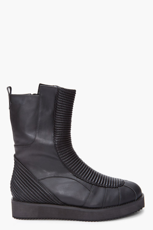 Black Mars Lo Man Boots by Jeffrey CampbellHigh top leather boots in black. Round tapered toe. A symmetrical collar. Pull loop at collar. Zipper closure at inner side. Tuck detailing at eyerow and heel. Thick rubber sole. Tonal signature stitching at toe and ankle.Click here