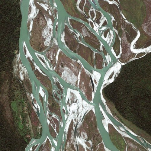 inothernews:  A RIVER RUNS THROUGH IT  Taken on March 17, this GeoEye satellite image shows a portion of the D. Ering Wildlife Sanctuary off the Siang River, directly above the Dibru-Saikhowa National Park, located about 7.5 miles (12 kilometers) north of Tinsukia, Assam, India. The sanctuary is named after the late legendary social reformer Daying Ering. The sanctuary consists of a series of islands in the Siang River that are home to endangered animals and many migratory birds.  (Photo: GeoEye via MSNBC)