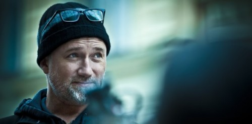 "6 Filmmaking Tips From David Fincher By Cole Abaius  Make the Calls Yourself ""What you learn from that first - and I don't call it 'trial by fire'; I call it 'baptism by fire' - is that you are going to have to take all of the responsibility, because basically when it gets right down to it, you are going to get all of the blame, so you might as well have made all of the decisions that led to people either liking it or disliking it. There's nothing worse than hearing somebody say, 'Oh, you made that movie? I thought that movie sucked,' and you have to agree with them, you know?"" Give Everything You Have and Know It Won't Be Enough ""I never fall in love with anything. I really don't, I am not joking. 'Do the best you can, try to live it down,' that's my motto. Just literally give it everything you got, and then know that it's never going to turn out the way you want it to, and let it go, and hope that it doesn't return. Because you want it to be better than it can ever turn out. Absolutely, 1000 percent, I believe this: Whenever a director friend of mine says, 'Man, the dailies look amazing!' … I actually believe that anybody, who thinks that their dailies look amazing doesn't understand the power of cinema; doesn't understand what cinema is capable of."" Directing is Ballet  [Hear it from the man himself] Look at Everything Through Two Different Eyes In the commentary track for Se7en, Fincher explains that when he was working at ILM, he was taught that a director should look at each scene's set up with each eye individually. Left eye for composition (because it's connected to the creative right side of the brain). Right eye for focus and technical specs (because it's connected to the mathematical left side of the brain) Know the Difference Between Films and Movies ""A movie is made for an audience and a film is made for both the audience and the filmmakers. I think that The Game is a movie and I think Fight Club's a film. I think that Fight Club is more than the sum of its parts, whereas Panic Room is the sum of its parts. I didn't look at Panic Room and think: Wow, this is gonna set the world on fire. These are footnote movies, guilty pleasure movies. Thrillers. Woman-trapped-in-a-house movies. They're not particularly important."" Have No Fear and Eat the Whale ""You can't take everything on. That's why when people ask how does this film fit into my oeuvre. I say 'I don't know. I don't think in those terms'. If I did, I might become incapacitated by fear … How do you eat a whale? One bite at a time. How do you shoot a 150-day movie? You shoot it one day at a time.""  Read the full article"