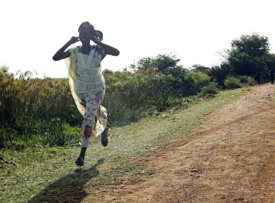 "fotojournalismus:   A woman runs along a road during an air strike by the Sudanese air force in Rubkona on April 23, 2012. Sudanese warplanes carried out air strikes on South Sudan on Monday, killing three people near a southern oil town, residents and military officials said, three days after South Sudan pulled out of a disputed oil field. A Reuters reporter at the scene, outside the oil town of Bentiu, said he saw a fighter aircraft drop two bombs near a river bridge between Bentiu and the neighboring town of Rubkona.  [Credit : Goran Tomasevic / Reuters]  ""I was travelling by car with some colleagues to the Sudan People's Liberation Movement (SPLM) headquarters when a fighter jet attacked the area and dropped a bomb about 150 meters away from us. This woman began running but really there's nowhere to run because you don't know where the next bomb will drop but people panic."" - GORAN TOMASEVIC, South Sudan (Reuters' Best Photos of the Year 2012)"