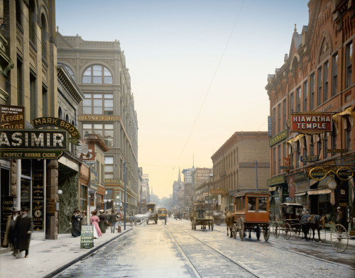 "St. Paul, Minnesota, circa 1908. ""Wabasha Street."" The early 20th century was a golden age of signcraft. Gilded wooden letters and 24K gold leaf window treatments were standard. Several classic lettering manuals were published during this time, with graphic styles influenced by Victorian ornament and the Art Nouveau movement. To an ex-sign painter (a profession killed by the computer, alas), Wabasha Street is a candy store. This is how I imagine it looked, a chilly morning in St. Paul one hundred years ago. Keen-eyed Shorpians may notice a couple of small modifications to the original photograph. View full size."