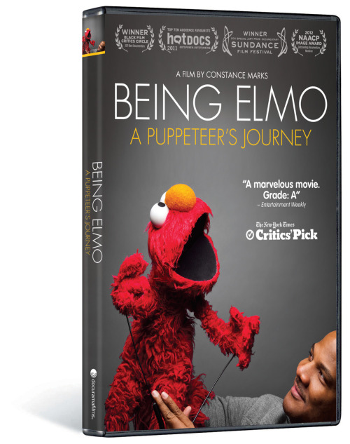 elmomovie:  We're giving away a free copy of Being Elmo! Re-blog this photo for a chance to win the award winning documentary. Who doesn't love Elmo?! Share with friends.