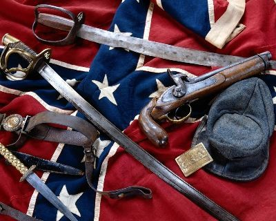 A selection of Confederate weapons including a pistol, a knife and swords.