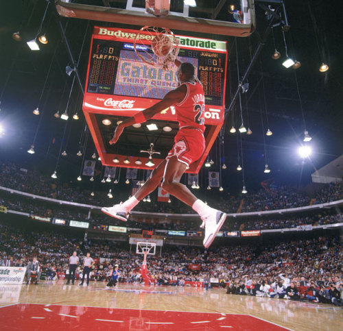 siphotos:  Michael Jordan slams one home at the 1988 NBA Slam Dunk Contest. Despite his success as a player, Jordan has struggled mightily since purchasing a majority stake in the Charlotte Bobcats. The team is on pace for the worst winning percentage in NBA history and according to SI's Michael Rosenberg, Jordan is to blame for the team's failures. (Walter Iooss Jr./SI) ROSENBERG: Jordan to blame for Bobcats miserable season