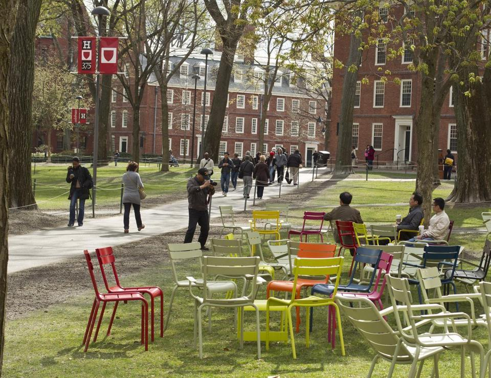 Harvard Yard transformed by colorful chairs  - What was once a place people simply passed through has become a gathering spot for both students and the community, thanks to a collection of lollipop-colored chairs.