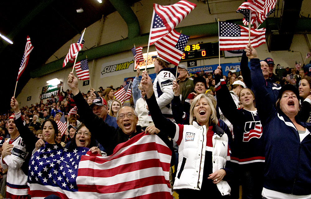 The Week in Pictures for April 2:  Team USA fans cheer after early goals in the first period at the IIHF Women's Ice Hockey World Championships at Gutterson Fieldhouse in Burlington on April 7, 2012  (Photo by SHANE BUFANO, for the Burlington Free Press)