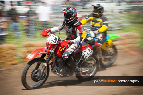 "I had the opportunity to photograph the motocross races at the San Joaquin County Fairgrounds last weekend. I had never been to the races so I wasn't sure what to expect.  What I found was a great group of people who seem to love off-road motocross racing! Everyone I met was friendly, even giving suggestions for positioning so I can get some great photos. I was worried I might have to setup behind a fence somewhere far from the action. I ended up on the track itself, and was able to move around to capture the action in a few different turns. The races started soon after I arrived and didn't stop all day. Riders get a break between races, but there is little time for a break during the event. The only real break came when someone was injured on the track. :( Luckily, I had brought everything I needed with me and was able to shoot most of the day without stopping. I tried two different ways to shoot this event. The first was with a wide-open aperture. In full sun, this gave me a high shutter speed to freeze the action. I love the way the dirt and rocks are frozen as they are shooting out from under a tire.  Shooting like this can give the photograph a rather ""static"" look—like the bikes are frozen in time and not moving. These bikes are moving pretty quick, so I would occassionally switch to a high aperture to slow down the shutter speed. With this motion I had to pan with the riders to keep them sharp while showing the effect of the motion.  I had a great time out in the field, even if my camera and I were filthy by the end of the day! I hope to get out and shoot motocross again! All photos are online at http://www.geofffaulkner.com/event/Motocross-Racing Geoff"