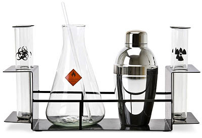 Mix up something good with this super cool Cocktail Chemistry Set from Think Geek. About:  There are several rules for cocktails - 1. You must be twenty-one. 2. - A proper martini is made with gin and not vodka (sorry, but it's true). And 3. - Constitutional isomers of dimethyl ether, when blended with a combination of citric acids and disaccharides are damned tasty. If you can live by these rules, then you can be a certified scientific mixologist: one who is capable of using their immense intelligence to create astonishingly awesome alcoholic beverages. We've got your starter set of glassware right here. Beakers, vials and lab-stand right out of a mad-scientist's laboratory.