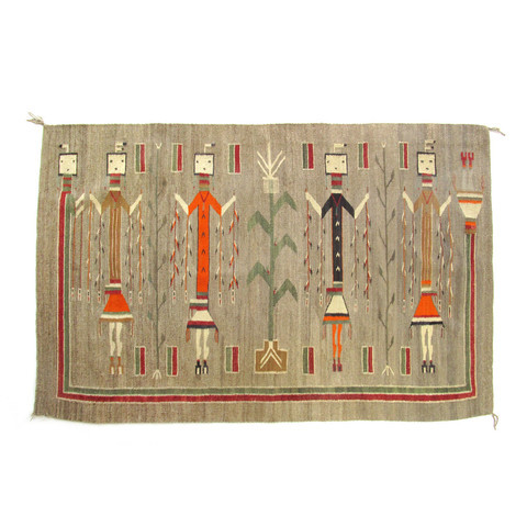 "Navajo Rug Masterpiece: Large Antique Navajo Rug in Yei Pictorial style from Lukachukai weaving region of the Navajo Nation, famous for this type of design.  46"" x 71"" Beautiful natural grey ground with dramatic Rainbow Yeibichai surrounding the four standing figures of masked warriors, parading in ceremonial regalia for their yearly healing ritual. They carry staffs of feathers and adorn themselves with earrings and necklaces of their finest jewelry. Bright orange aniline dye was used for the wool in some of skirts, shirts, and even in the legs of one of the figures.  This color has not run or faded, quite rare indeed.  The detail is incredible, especially being these are made from memory without any plans or drawings.  From the feathers on their heads, to their shapely calves and stunning condition. The designs for these weaving come from sacred sand paintings that are destroyed after each use.  At first they were frowned upon when woven into permanent rugs such as these by the medicine men that practice this ancient religion.  The maker will often include a spirit line on the border of the tapestry so that any sacred energy can escape. This rug is so precious it is usually only hung up.  The back side shows a strip of linen that has been added for secure attachment to the wall.  George's parents always displayed this masterpiece in their family room and he hopes to do the same in the home he makes with Ruby…"