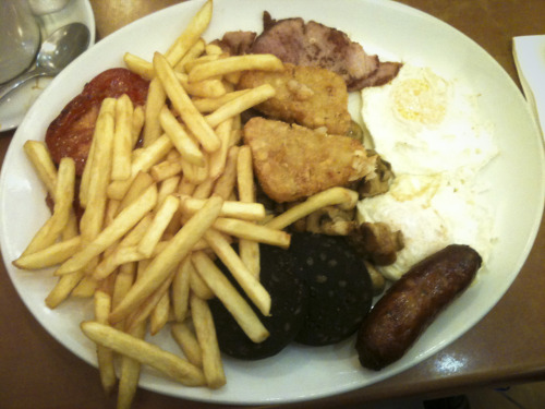 "4/14 - My first proper English ""fry up"". All of this greasy breakfast magic with Coffee for under £7 served by 3 lovely Polish girls. The boys say each one is more lovely than the next but I argue its all about the blonde middle girl. Also discovered the beauty and wonder that is HP Brown Sauce. Heinz 57 may have just been declared redundant. I might have to bring some gallons of the stuff back to the US with me. Pedro's Cafe - Kentish Town"