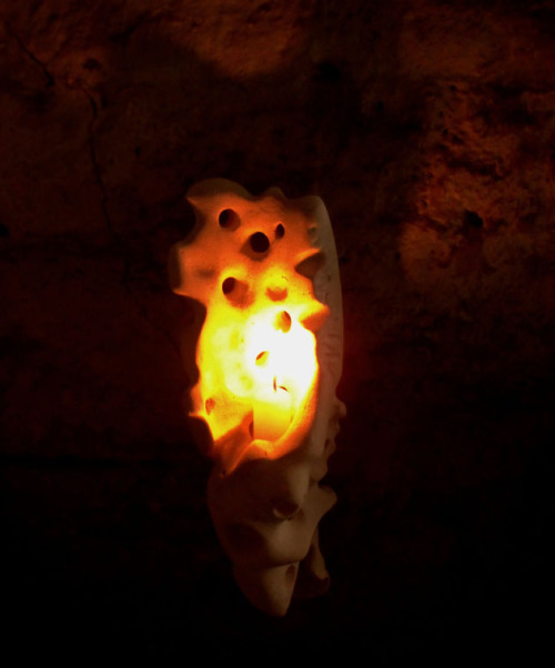 Whack a candle in it and spark it up! Hand carved stone wall sconces available from www.ruffrootcreative.com.
