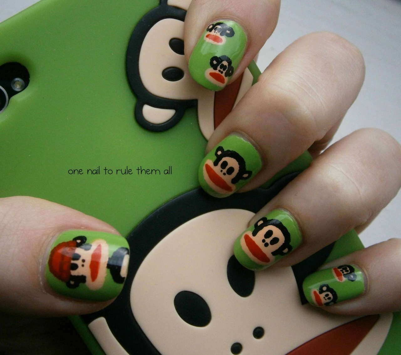 onenailtorulethemall:  Paul Frank nails, based on my awesome phone case. For more photos and information click the photo :)