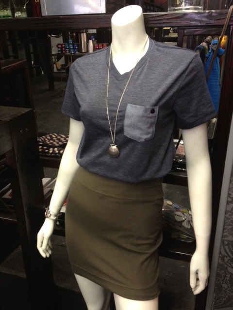 "Mix girly with sporty in this tee & skirt combo! Check out that cute denim pocket! Pair this tee ($24) with a flattering army green mini skirt and some keds for a complete ""boy meets girl"" look. Wanna get more girly? Then throw on an adorable shell locket necklace ($24) and a matching bracelet ($16).  All pieces available at 5th Stitch in the Castro!"