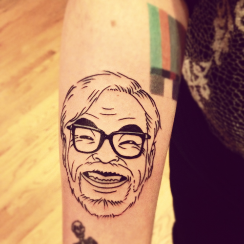 This is my tattoo of Hayao Miyazaki done by Creamy at True Blue in Chicago. I almost forgot to give him credit for the incredible job he did. I've always loved Miyazaki's work and wanted to pay tribute to the coolest/most adorable man in existence…by putting his face on me. The image itself is based off of a drawing I found floating around on the internet, I'm not sure who the original artist is.