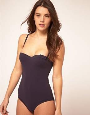 all i want for the summer is a plain black one piece.. this is one of the hardest items of clothing to find anywhere.. luckily this comes close. huit padded strapless swim suit @ asos