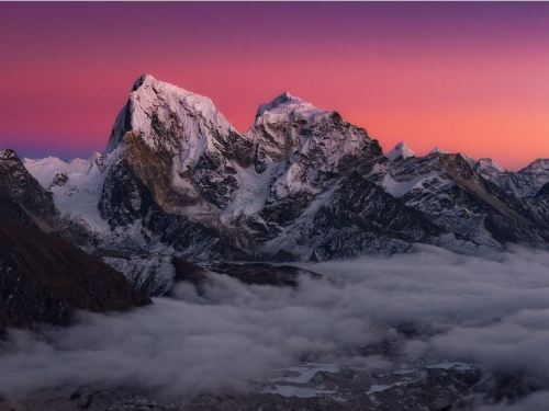 Arakam Tse and Cholatse tower above the Ngozumpa Glacier in the Gokyo Valley, Nepal.