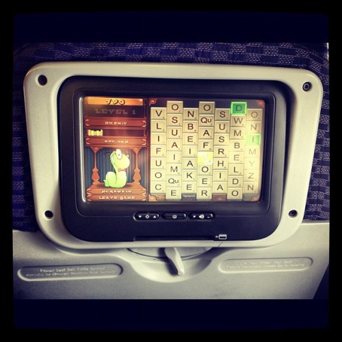 Playing some bookworm on my flight to LAX. (Taken with instagram)