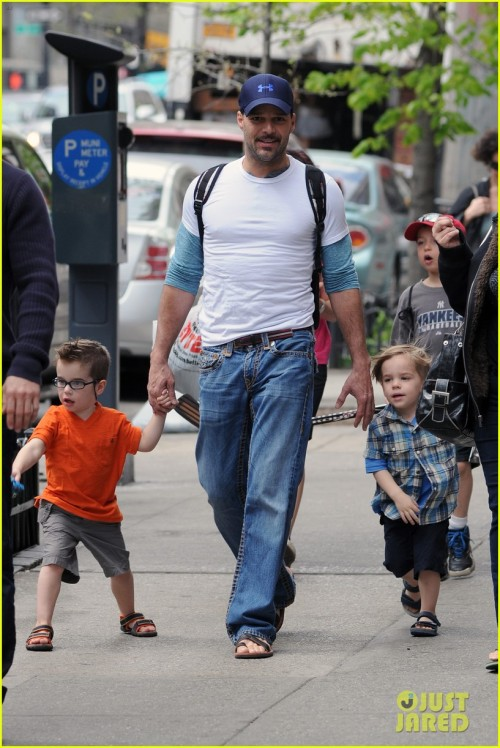 Breaking news: one of Ricky Martin's twins has glasses. (Unfortunately, both have shoes with Velcro.)