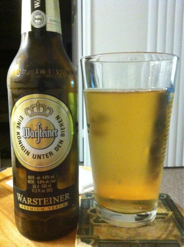 "Warsteiner Premium Verum Appearance - Pours a crystalline yellow, almost like a dehydrated man's piss. Super clear ambering yellow in color. A thick fat white head with good retention and lots of carbonation racing through the glass. Smell - It smells tart and slightly buttery, an almost tang of citrus. Hops are light and tangy slightly and very clean. Taste - Tart and citrusy. Cool and crisp. The malts are tangy and stinging. Fits the pils style well. Mouthfeel - Very bubbly and crisp on the tongue and well carbonated. Light and coarse on the tongue. It's got the pilsner's slightly skunked and scabby tang. After taste is fresh and light on the edges of the tongue, but slightly more thick on the tongue's back. Overall – Not a bad pils, nice malty flavoring with a cool crisp tang to the mouth. As a side note, I love the word ""tang""… It just has a nice tang to it's sound…"