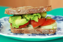hummuslove:  Toasted tomato, avocado, cucumber & hummus sandwich (by SweetOnVeg)