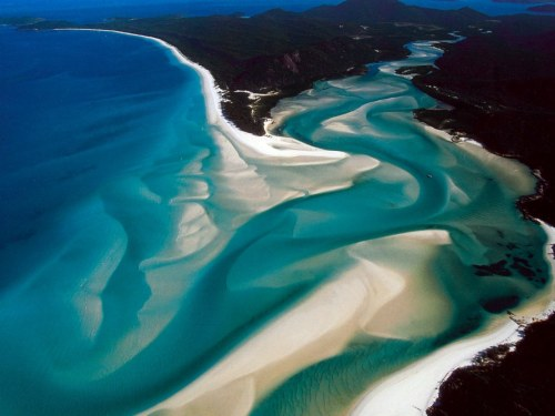 The Whitsunday islands off the northeastern coast of Australia boast a landscape marbled with glistening white sands and impossibly clear turquoise waters. [Map] [Wiki]