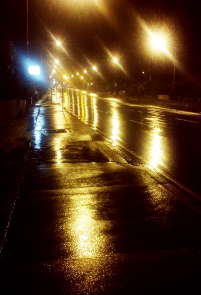 Rain on Woodville Road at night.
