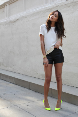 what-do-i-wear:   Shorts: Twenty Cluny. Silky T. Shirt: Tory Burch. Neon shoes: Christian Louboutin. Crow Skull Ring: Courtesy of Bad Passion. Watch: Michael Kors.(image: ashley-ringmybell)