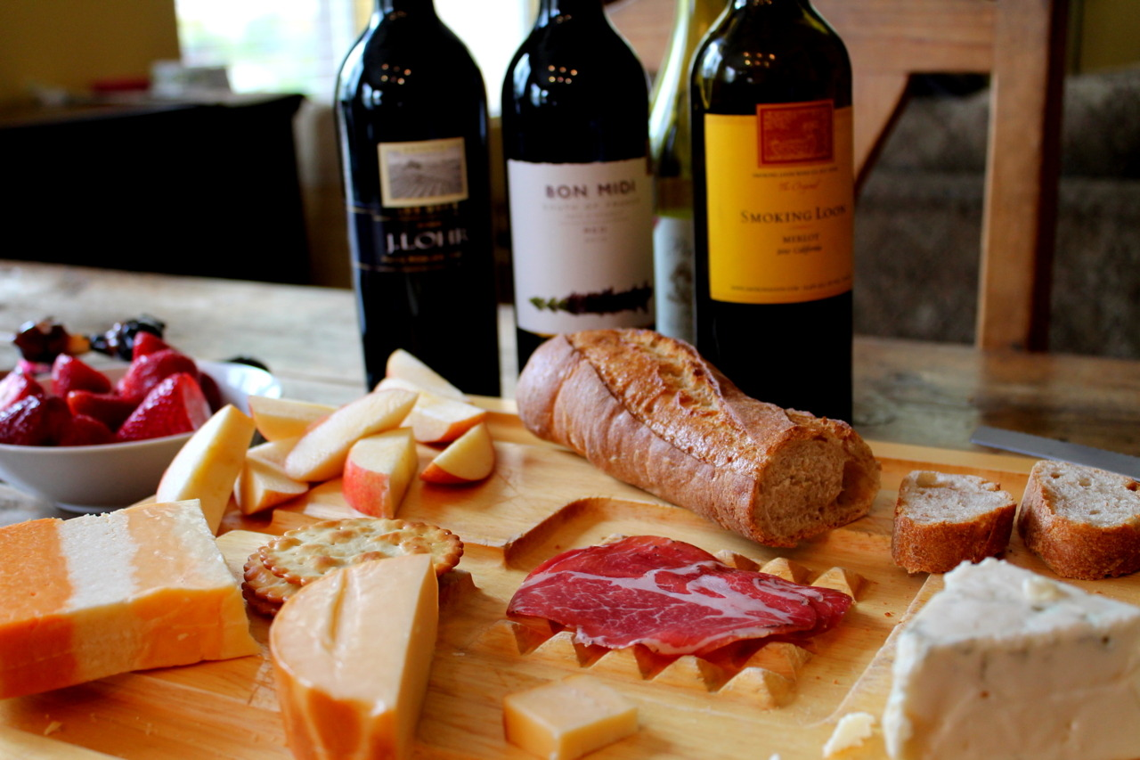 Wheat baguette, cheeses, coppa, apple, and berries. Oh, and plenty of red wine, of course.