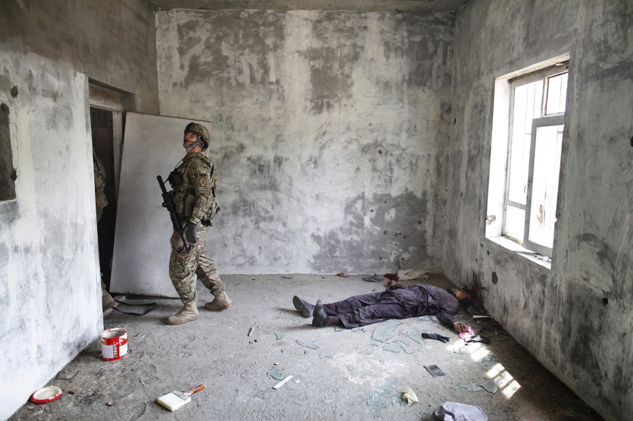 An American soldier clears a room in a building held by insurgent gunmen for eighteen hours in downtown Kabul last week. Photo: Javier Manzano The war in Afghanistan is not over. Help us tell the story. Fund our Kickstarter.